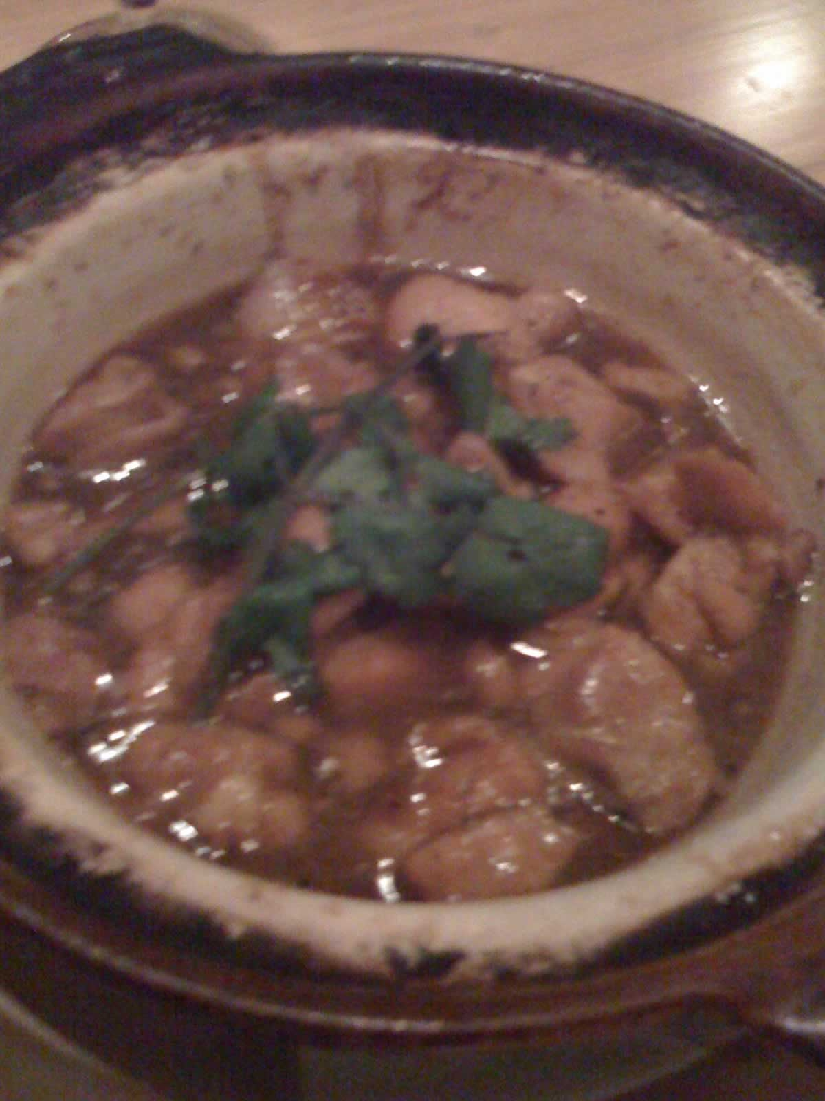 Chicken claypot with caramel sauce, chiles and fresh ginger